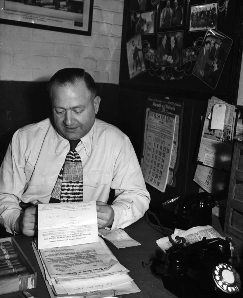 7th February 1948:  Fight promoter Jack Solomons receiving his call-up papers from the Ministry of Labour.  (Photo by Stanley Sherman/Express/Getty Images)
