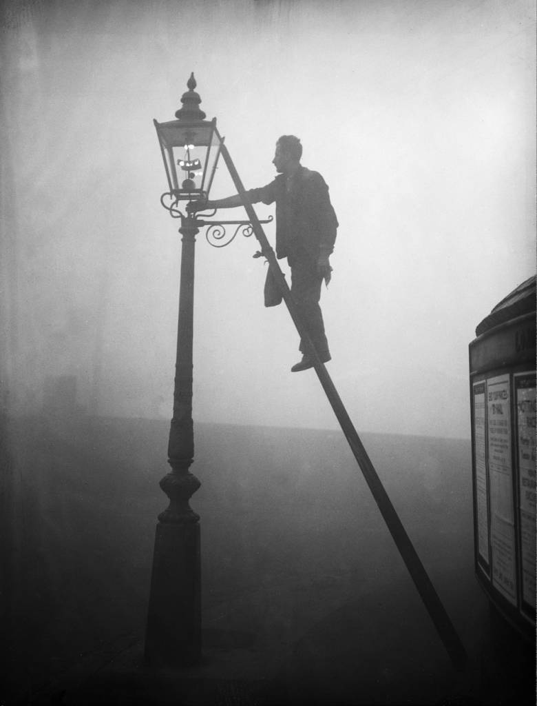 7th October 1935:  A lamp lighter at work in Finsbury Park, London.  (Photo by E. Dean/Topical Press Agency/Getty Images)