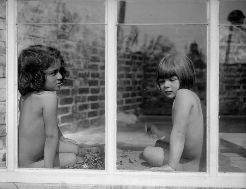 7th April 1930:  Two young nudists attend an open air school at Brackenhill, Tunbridge Wells.  (Photo by Fox Photos/Getty Images)