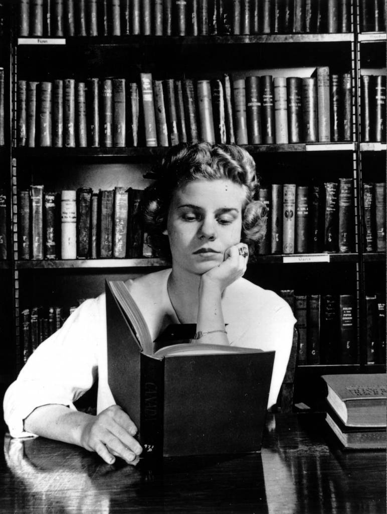 circa 1955: A student reading in a library. (Photo by Keystone/Getty Images)