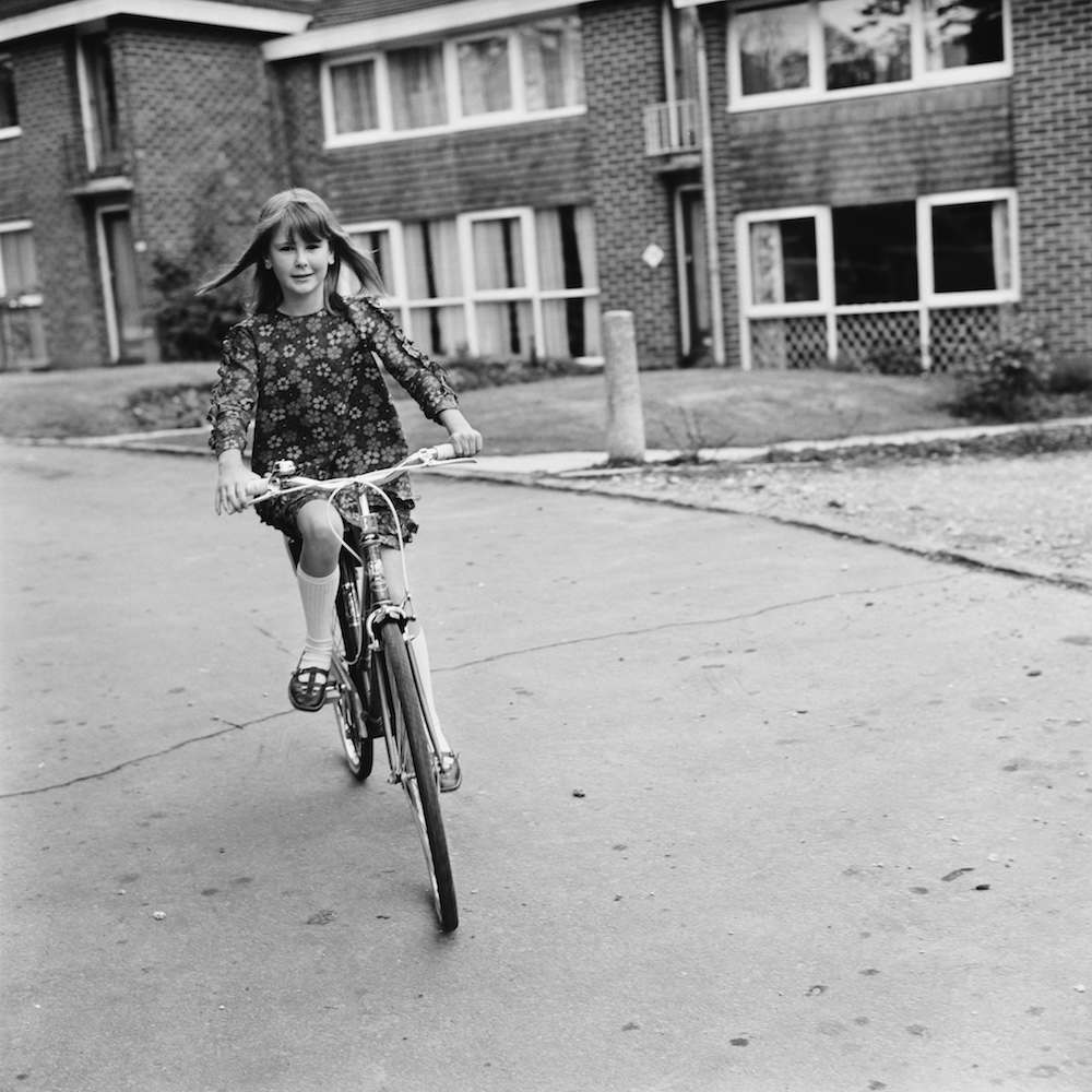 Ten year-old Caroline Bastin riding a bicycle outside her home in Waterlooville, Hampshire, 7th June 1968. (Photo by C. Woods/Daily Express/Hulton Archive/Getty Images)