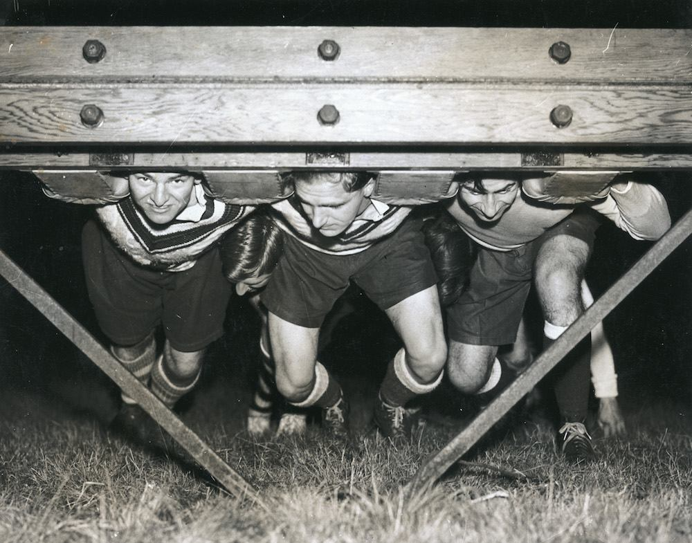 The Sale Rugby Club practise a scrum during a night training session, 7th December 1937. (Photo by Fox Photos/Hulton Archive/Getty Images)