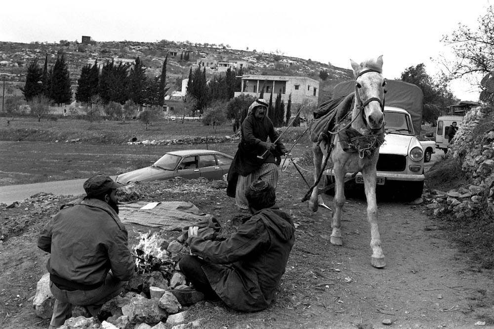 ARAB FARMER FROM KADDUM VILLAGE (IN BACKGROUND)   CROSSING GUSH EMUNIM SQUATTERS CAMP SET UP BY THE ELON MOREH GROUP AT ROADSIDE WEST OF NABLUS.