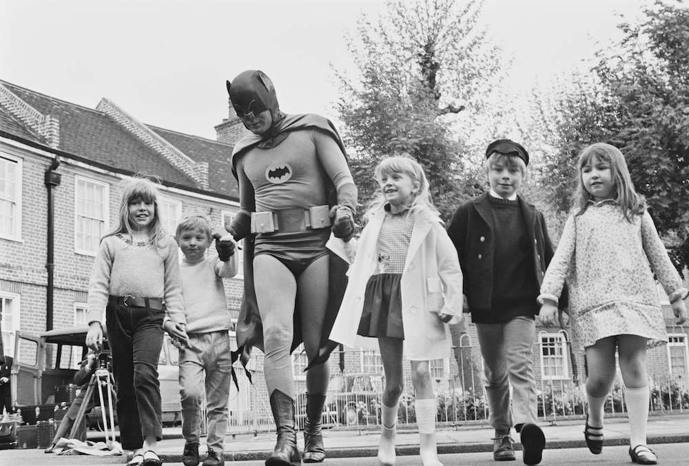 American actor Adam West dressed as 'Batman' for the  filming of a road safety advert for children, 7th May 1967. (Photo by Watson/Express/Hulton Archive/Getty Images)
