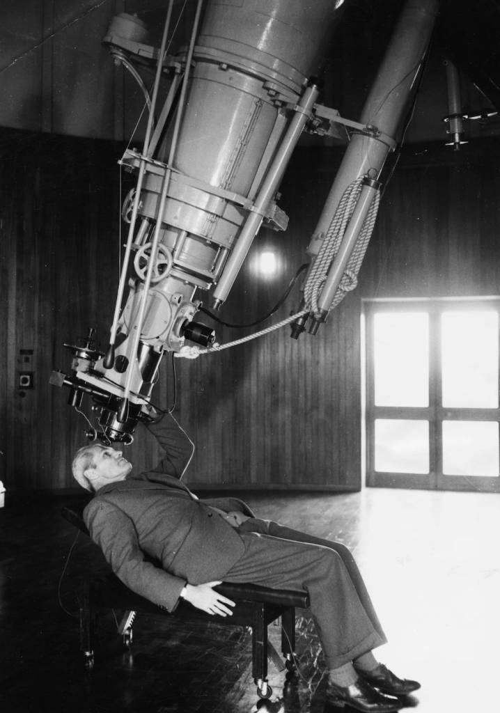 Portrait of Richard van der Riet Woolley, new Astronomer Royal, reclining back as he looks through a giant equatorial telescope, at Greenwich Observatory, Herstmonceux Castle, July 7th 1956. (Photo by Douglas Miller/Keystone/Getty Images)