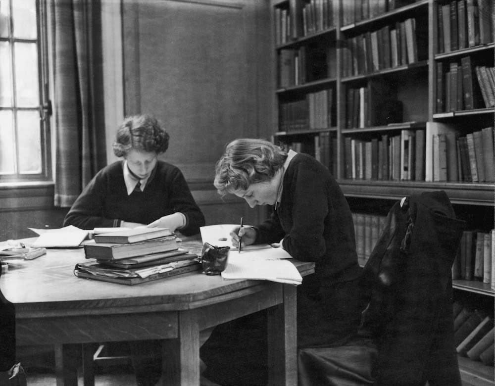 Sixth form pupils at work in the library at Christ's Hospital girls' school in Hertford, 3rd March 1953. (Photo by Monty Meth/Topical Press Agency/Hulton Archive/Getty Images)