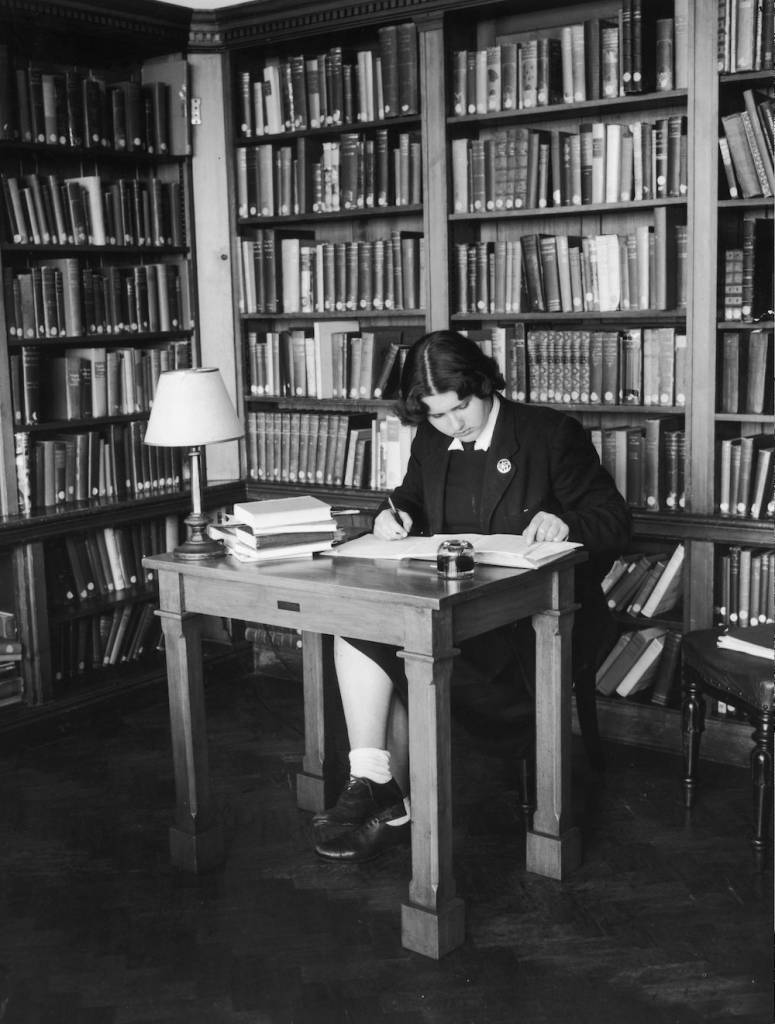 A sixth form pupil at work in a bay in the library at Roedean public school for girls in Sussex, August 1955. (Photo by L. Blandford/Harrison/Topical Press Agency/Hulton Archive/Getty Images)