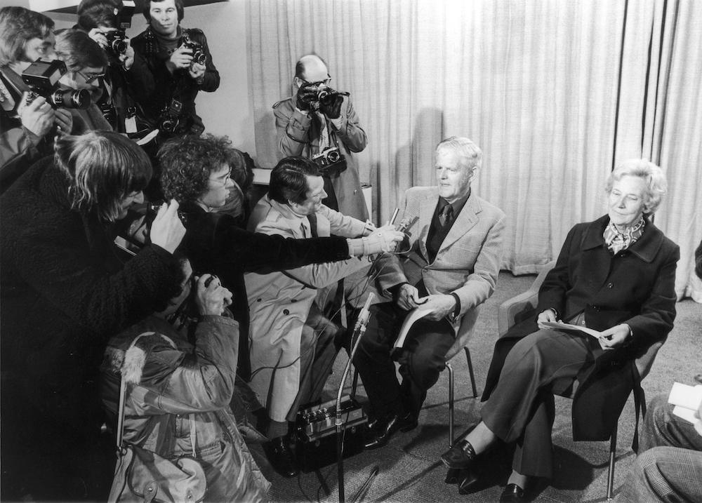 Garfield Todd (1908 - 2002), former prime minister of Southern Rhodesia, arrives at London Airport with his wife Grace for a month-long stay in Britain, 7th February 1976. He is met by reporters and photographers for an immediate press conference. (Photo by David Ashdown/Keystone/Hulton Archive/Getty Images)