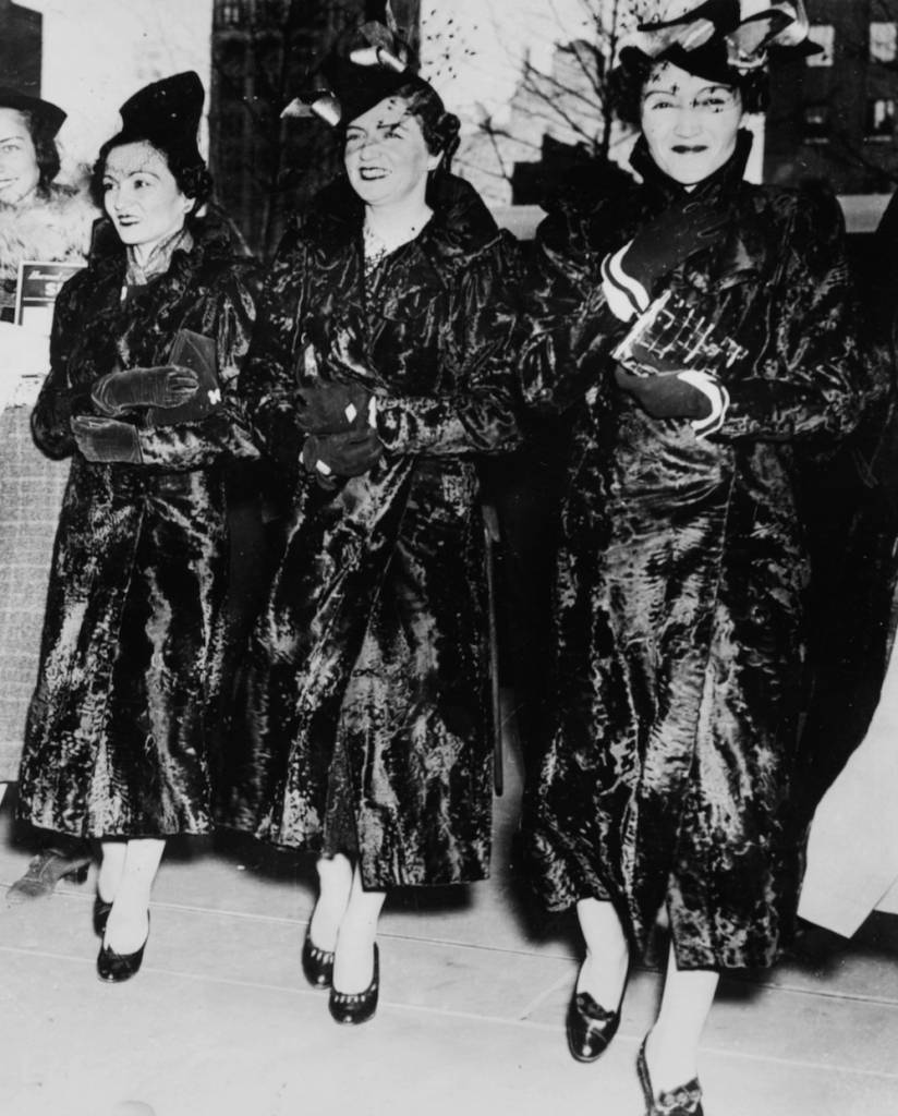 Portrait of the three Zog Princesses of Albania; (L-R) Rhuije, Maxhide and Myzeyen, wearing matching black karakul coats and hats, during a visit to the girl scout headquarters, Radio City, New York, March 7th 1938. (Photo by Keystone/Hulton Archive/Getty Images)