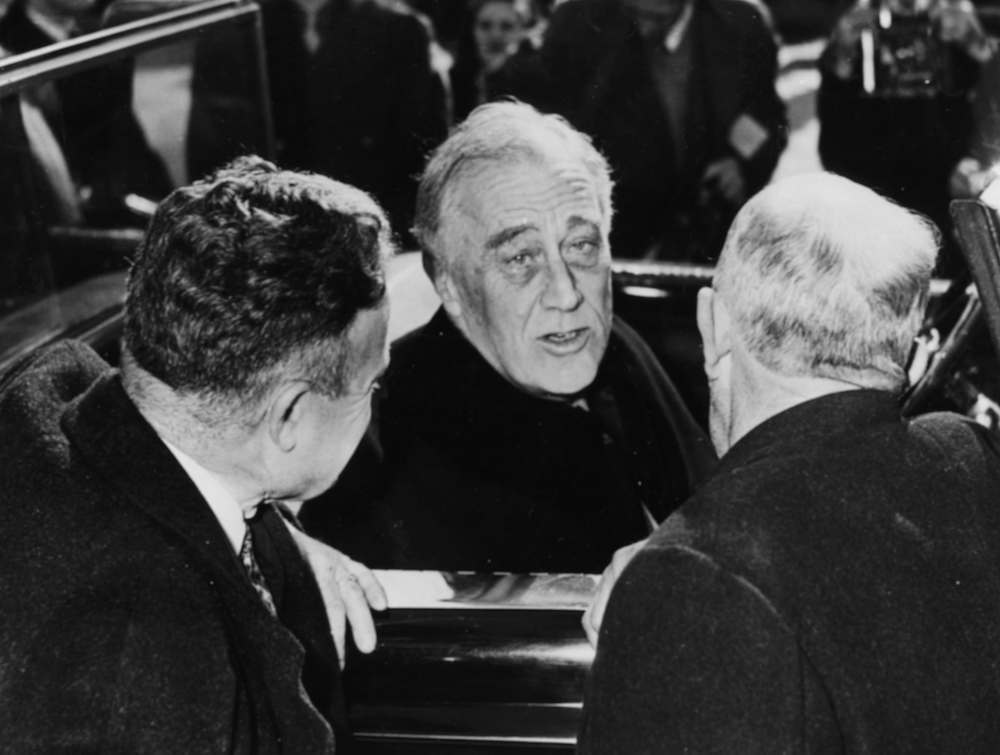 President Franklin D Roosevelt (centre) speaking to two voters from his car, after casting his own vote for the Presidential election at the Old Town Hall, Hyde Park, New York, November 7th 1944. (Photo by Keystone/Hulton Archive/Getty Images)