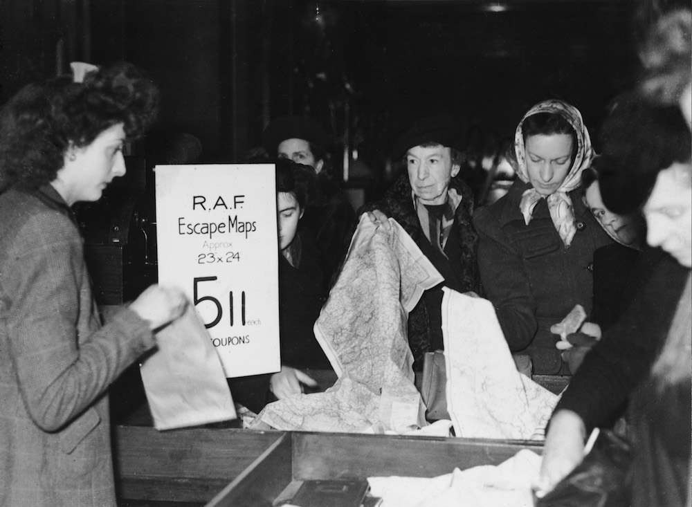 Women buying scarves recycled from RAF escape maps in a London shop, 7th December 1945. (Photo by Keystone/Hulton Archive/Getty Images)