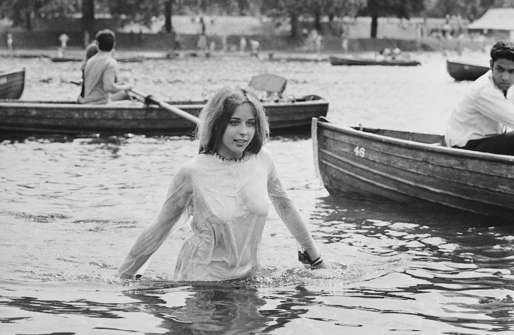 A teenage girl cooling off in the Serpentine during the Rolling Stones concert in Hyde Park, London, 5th July 1969. (Photo by Reg Burkett/Express/Getty Images)