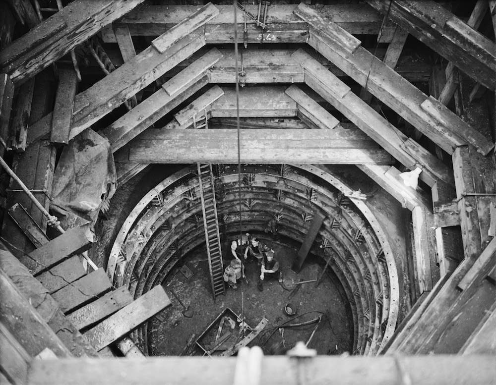 Workers in one of the deep shafts at the site of the new Bankside Power Station on the south bank in Southwark, 7th January 1949. (Photo by Harry Todd/Fox Photos/Getty Images)