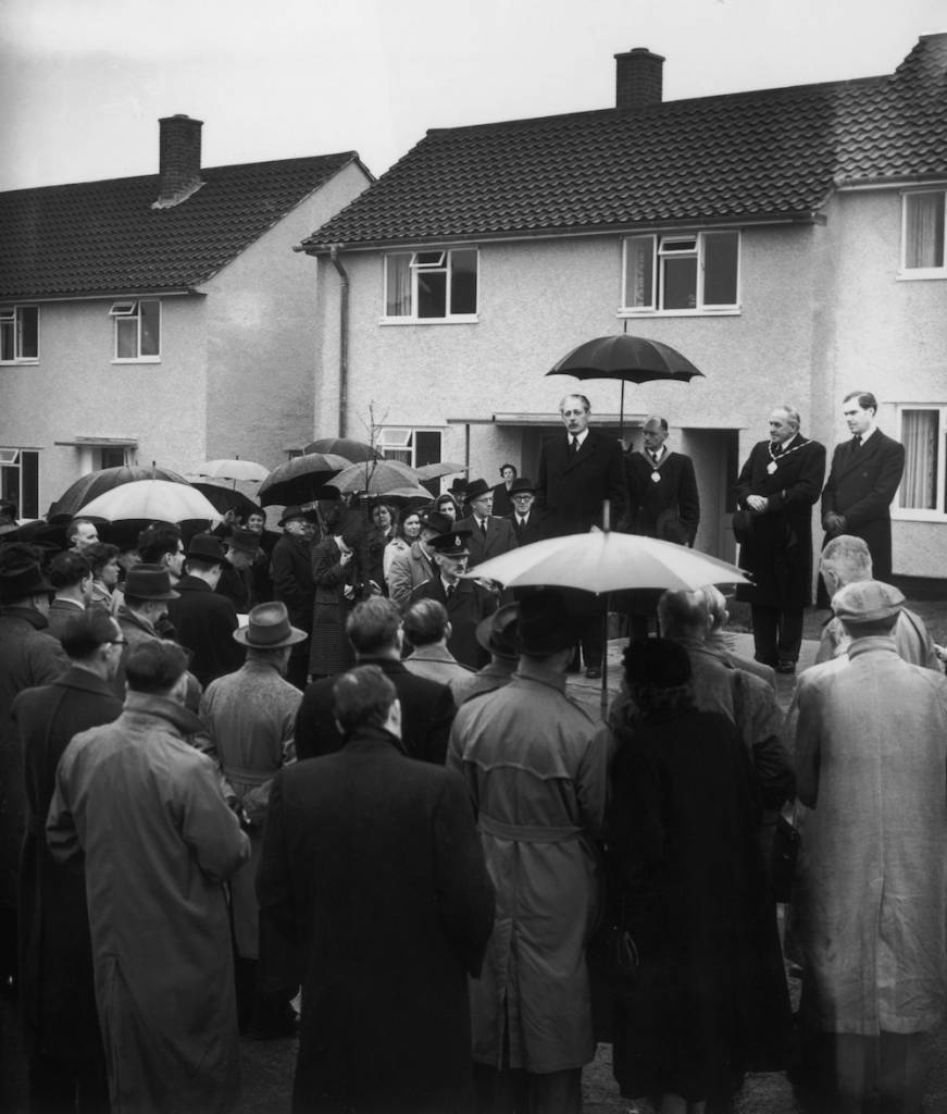 Harold MacMillan (1894 - 1986), British Minister of Housing and Local Government, opens a block of six houses on the Eastcote Estate in Middlesex, 7th March 1952. The houses, built by Wimpey, were erected in only seven weeks. (Photo by Edward Miller/Keystone/Hulton Archive/Getty Images)