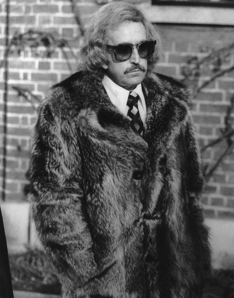 British nightclub owner and publisher Paul Raymond (1925 - 2008) attends the funeral of TV magician David Nixon at Streatham Cemetery, 7th December 1978. (Photo by Keystone/Hulton Archive/Getty Images)