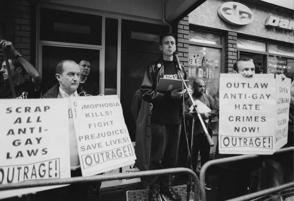 Human rights activist Peter Tatchell (centre) at a vigil organized by the direct action gay rights campaigning group OutRage! in Old Compton Street, Soho, London, 7th May 1999. The gathering follows the bombing of the Admiral Duncan, a gay pub on the street, by Neo-Nazi David Copeland on April 30th. (Photo by Steve Eason/Getty Images)