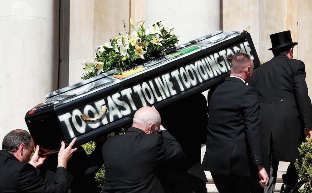 Malcom McLaren's coffin is carried into church at his funeral in North London on April 22, 2010 in London, England.