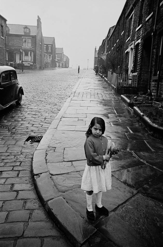 Girl playing on a Bradford street corner, 1969