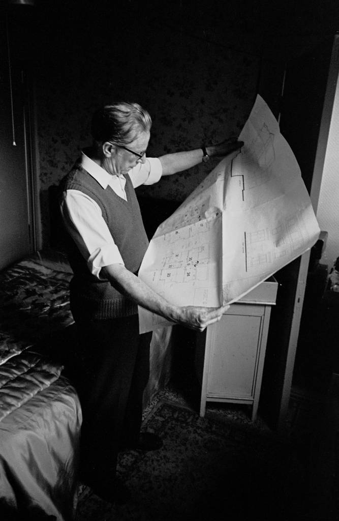 Householder looking at SNAP plans for his house Liverpool 8 1969