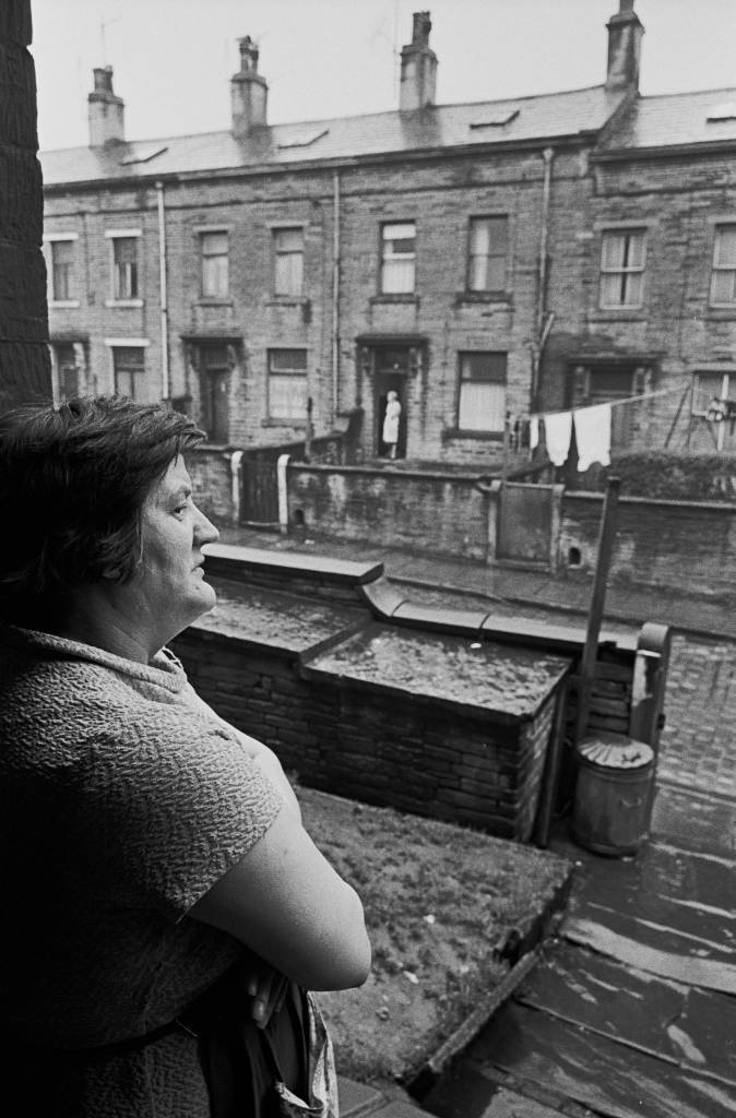 Housewife in doorway of  Bradford house, 1969