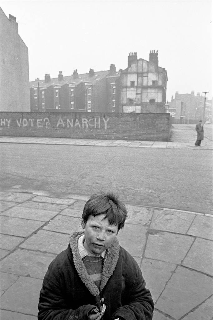 Liverpool, 1969 A young boy on the corner of a Liverpool 8 street