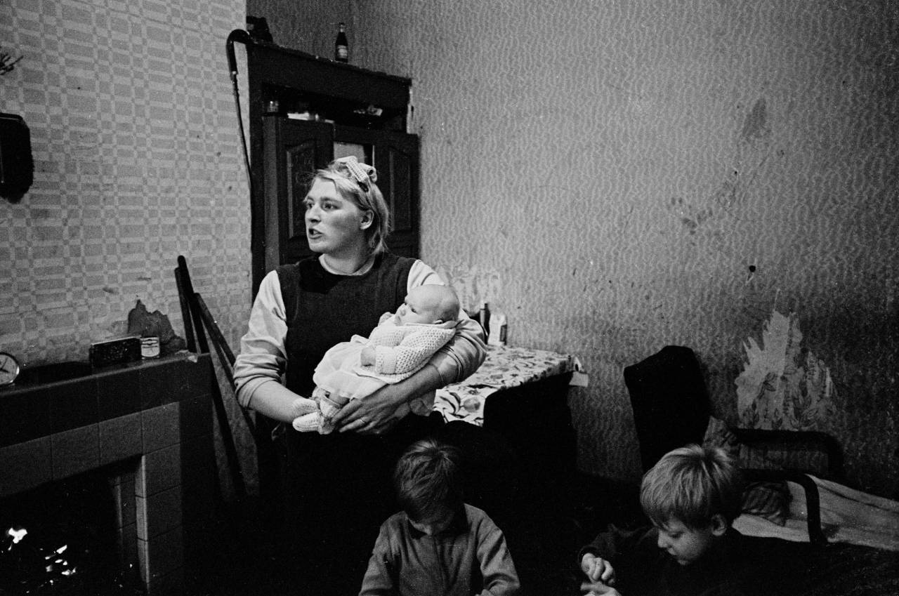 Mother and 3 children in multi let house, 1970