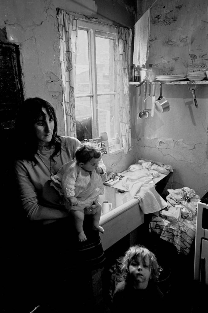 Mother and children dealing with the washing Salford 1971