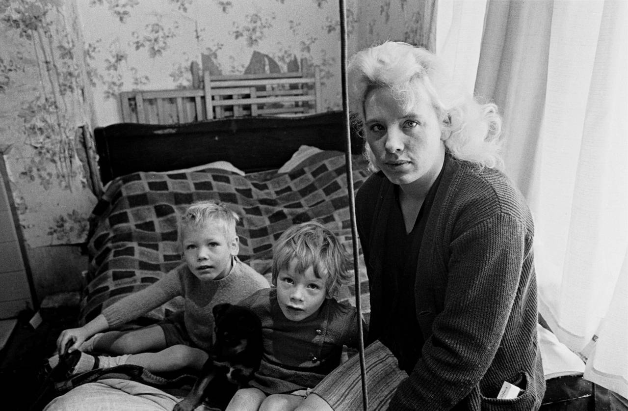 Mother and children living in slum housing Liverpool 8 1970
