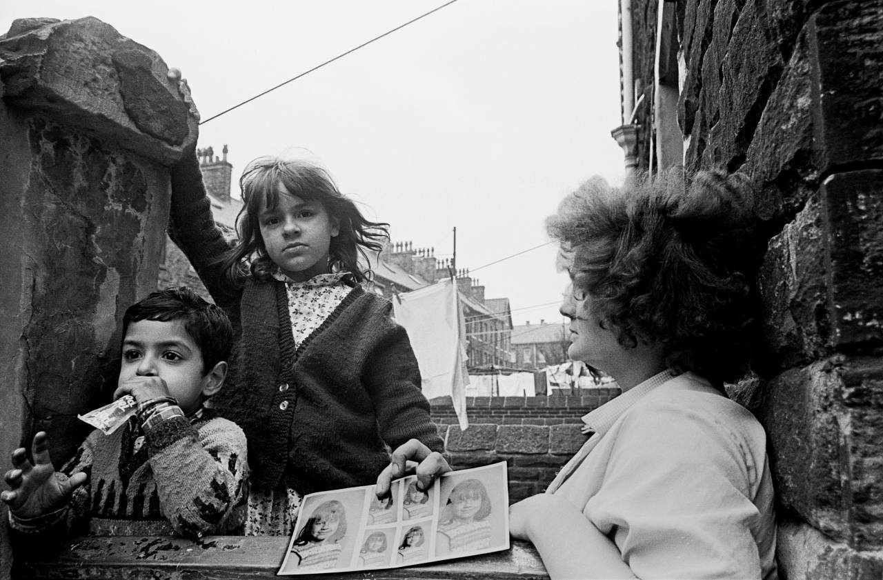 Mother and children with school photos, Bradford 1969