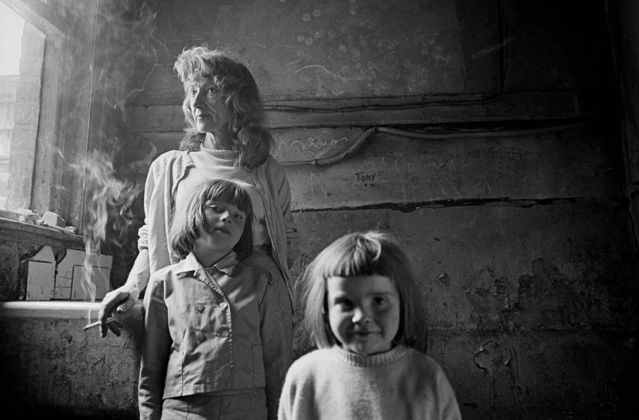 Mother and her 2 daughters living in a substandard property in Manchester 1969