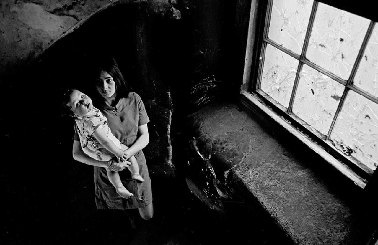 Mother and her baby on the staircase of her condemned Gorbals tenement 1970