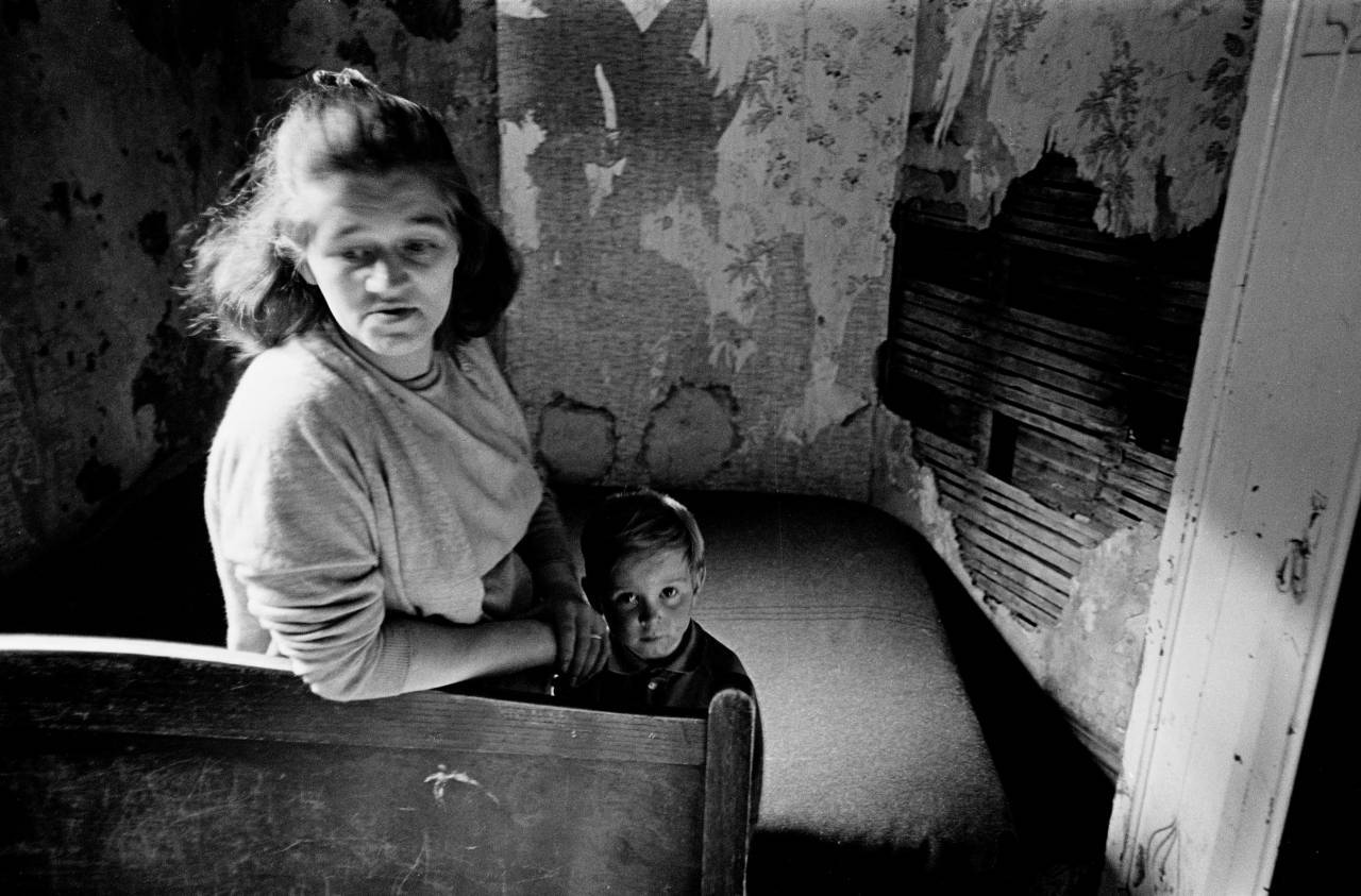 Mother and son in slum housing Manchester 197