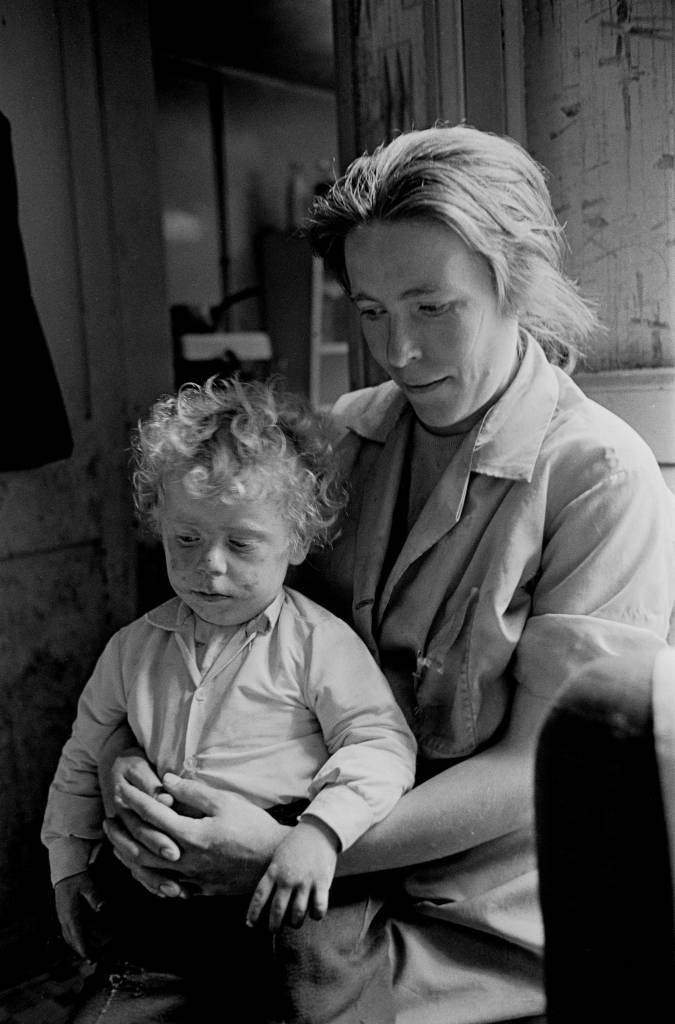 Mother and toddler in Manchester slum housing 1971