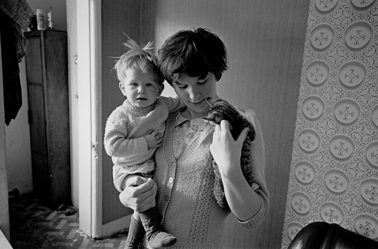Mother child and kitten living in slum property N London 1971