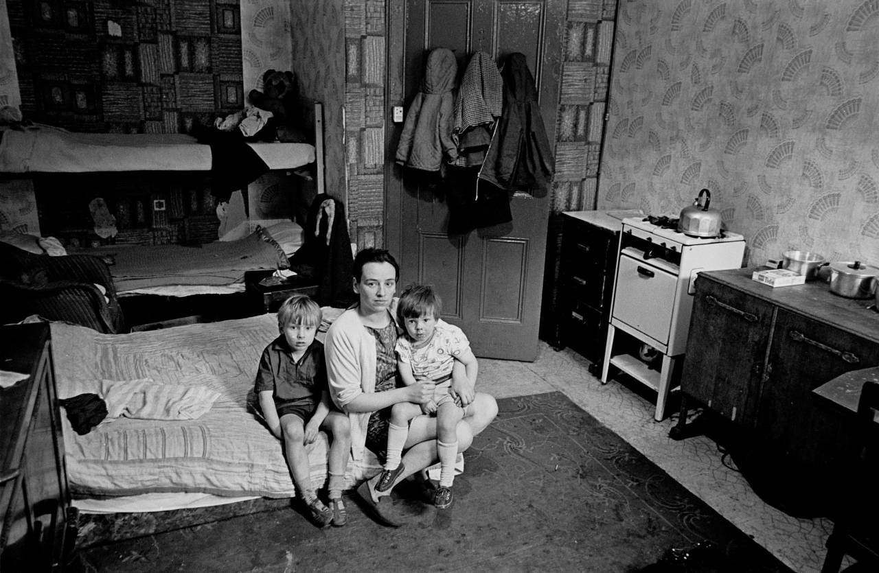 Mother living with her children in an overcrowded single end tenement flat Glasgow 1971