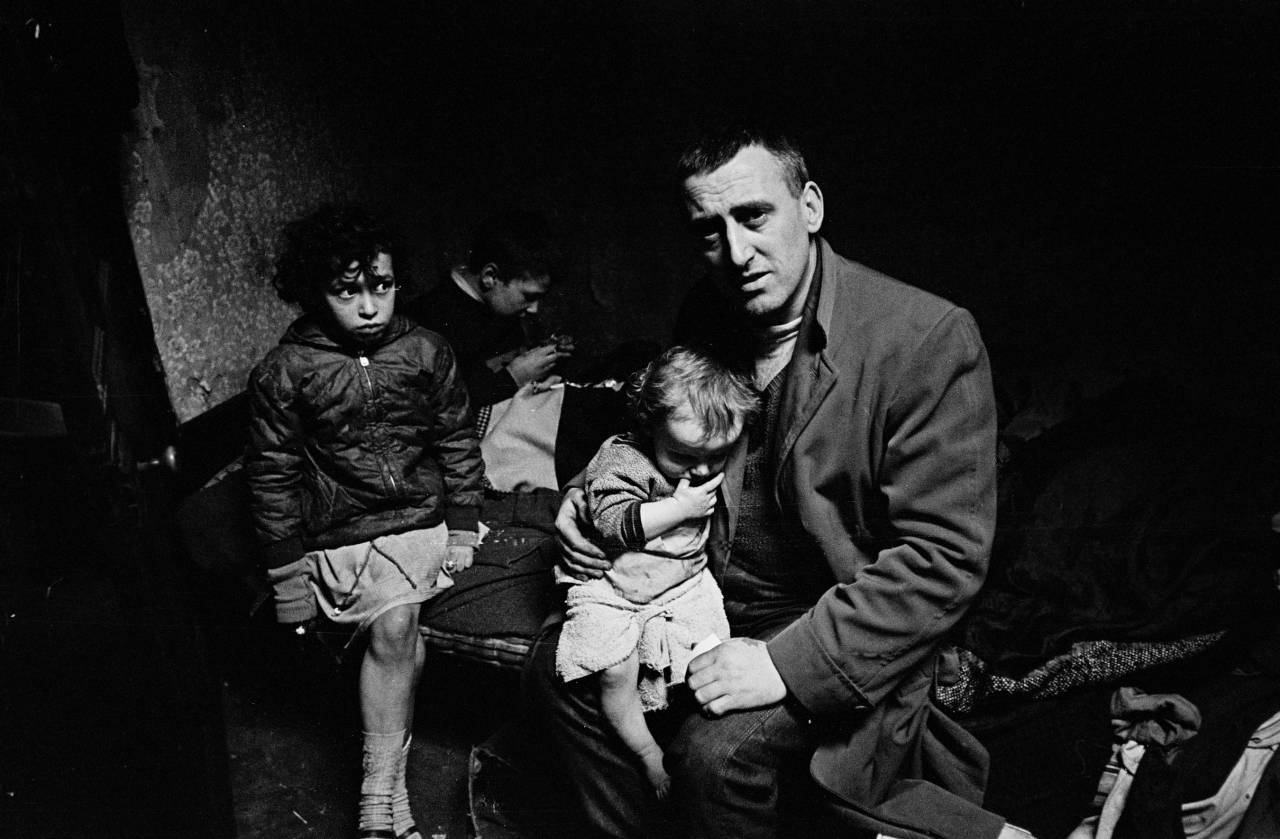 Mr Owen and his family living in a semi derelict house, 1969
