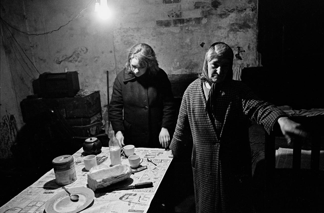 Mrs Ditchfield and her daughter living in cellar of multi let house, 1969
