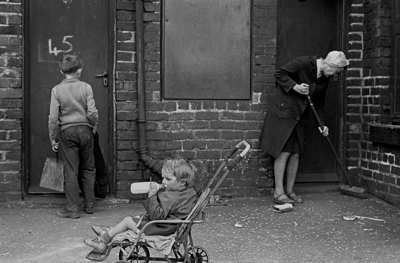 Mrs Tandy cleaning her backyard, Sheffield 1969