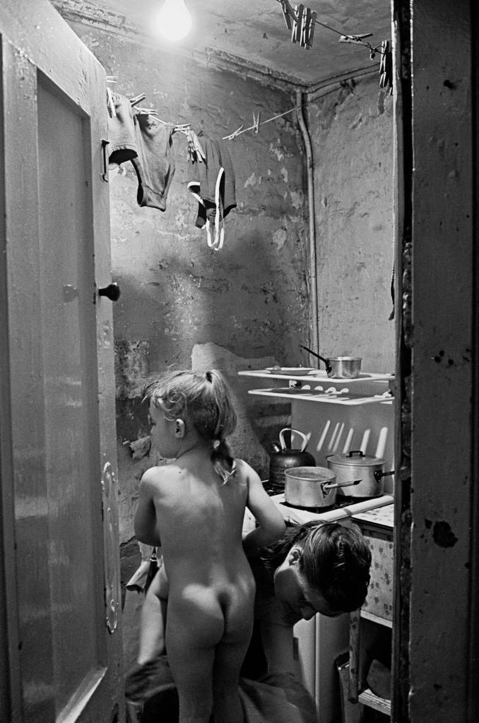 Peggy Rump drying one of the twins at bathtime, 1969