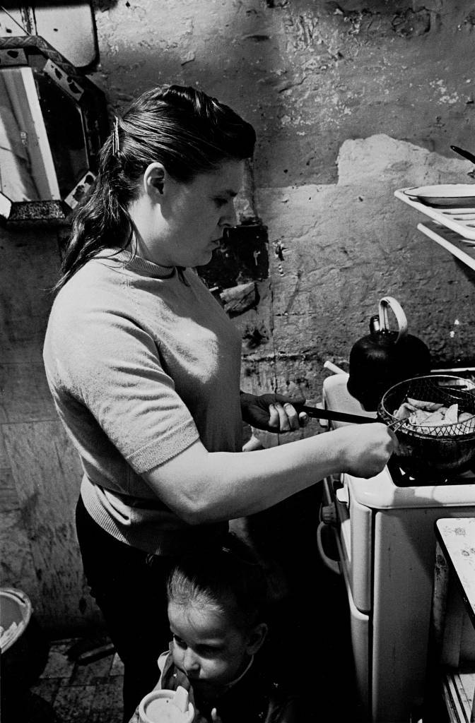 Peggy Rump frying chips in kitchen, Rothschild dwelings 1969