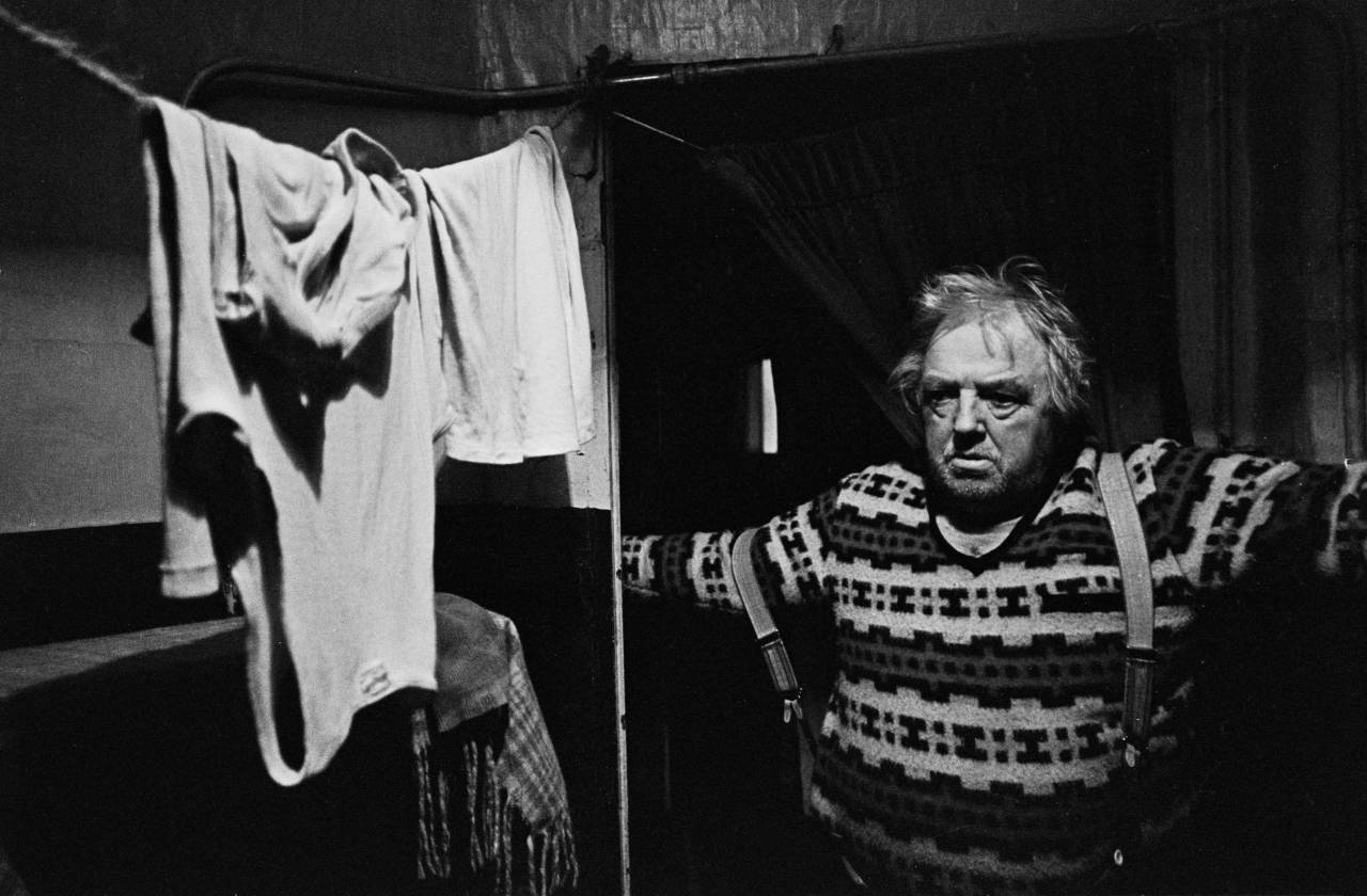 Portrait of elderly single man in his basement flat, Lambeth 1970