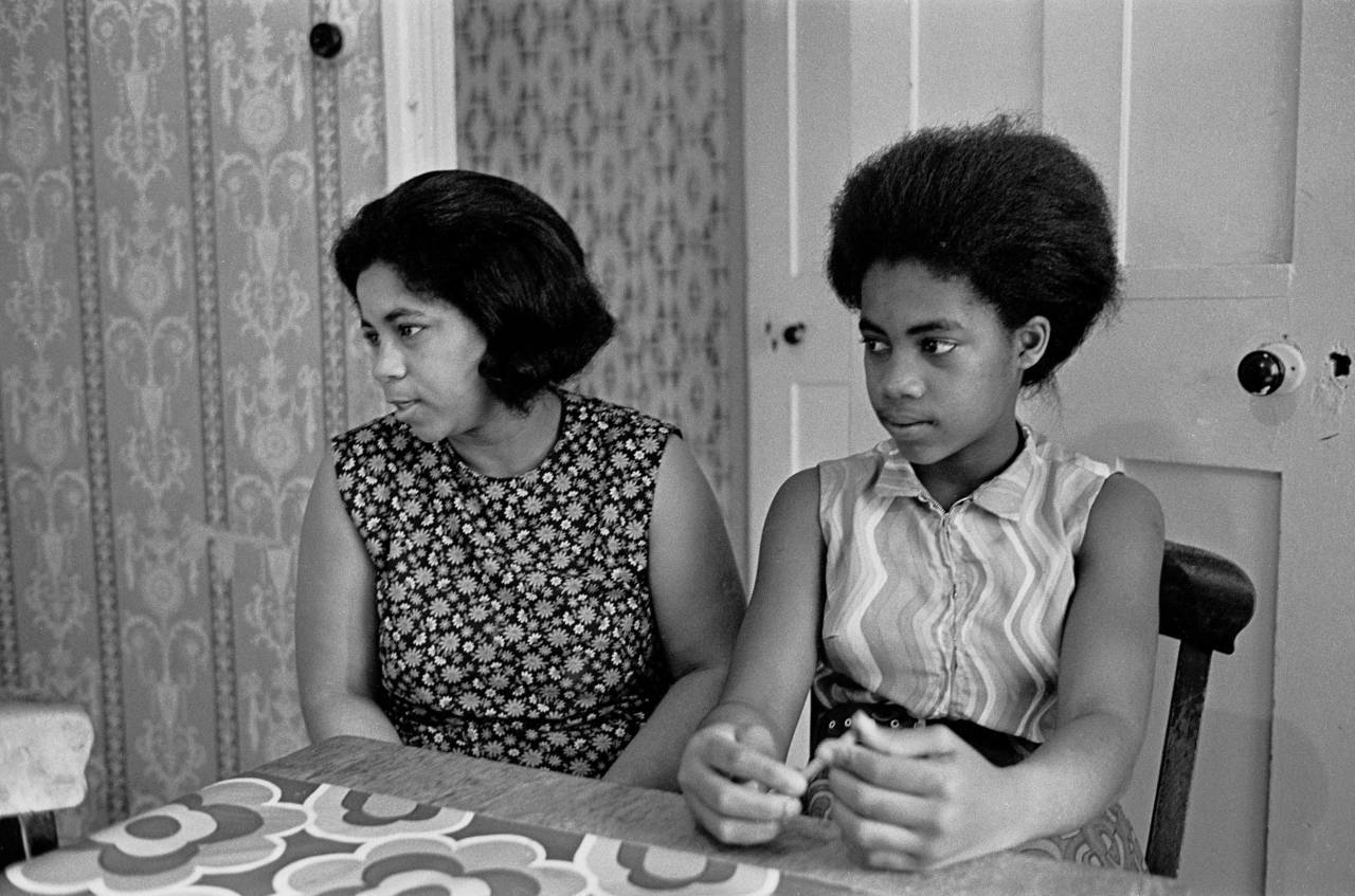 Portrait of mother and daughter living in poor housing Brixton 1972