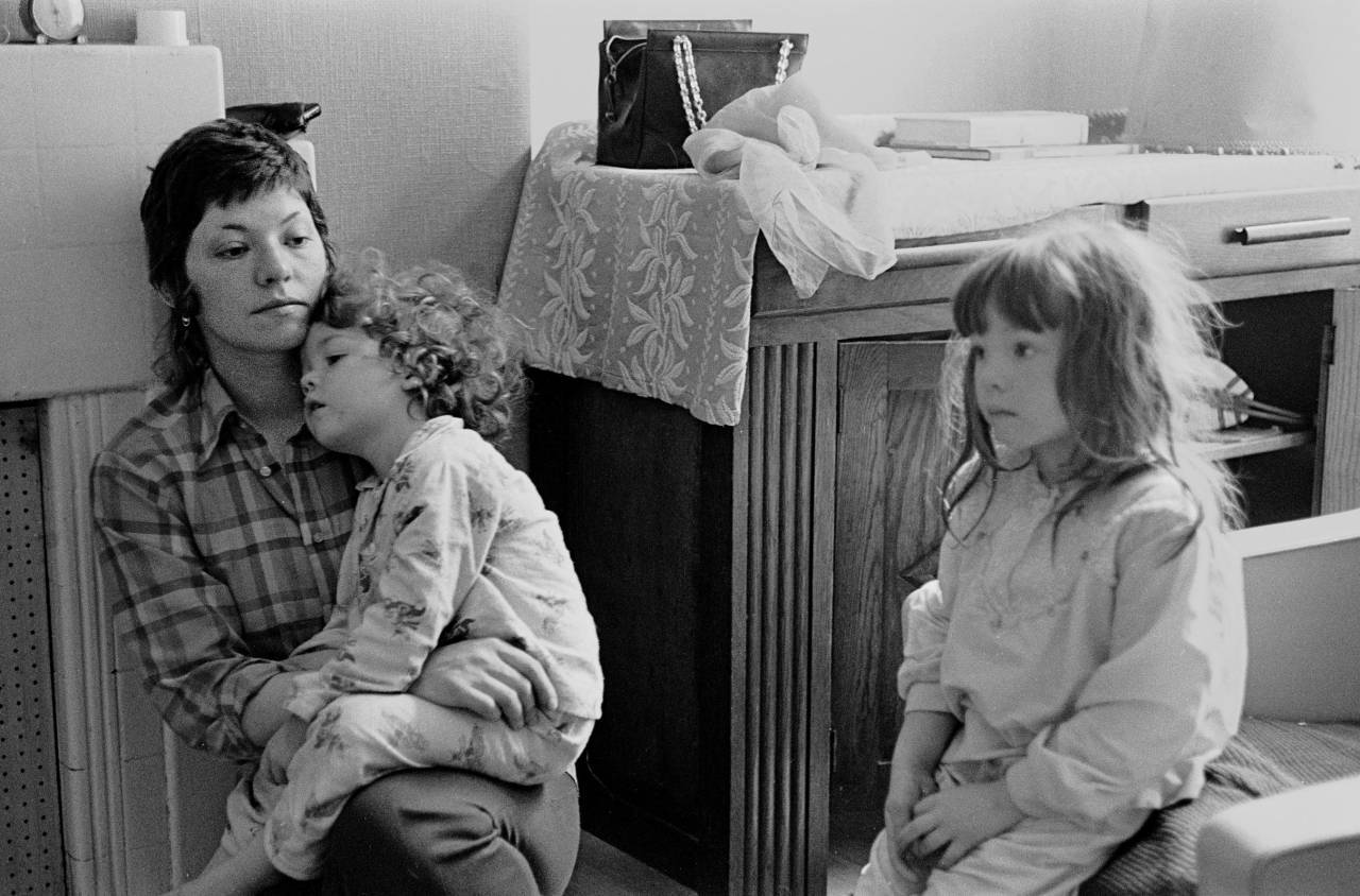 Portrait of mother and her children living in temporary accommodation South London 1971
