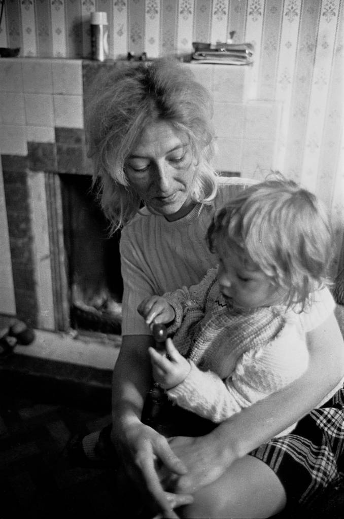 Portrait of mother and toddler living in overcrowded housing South London 1971