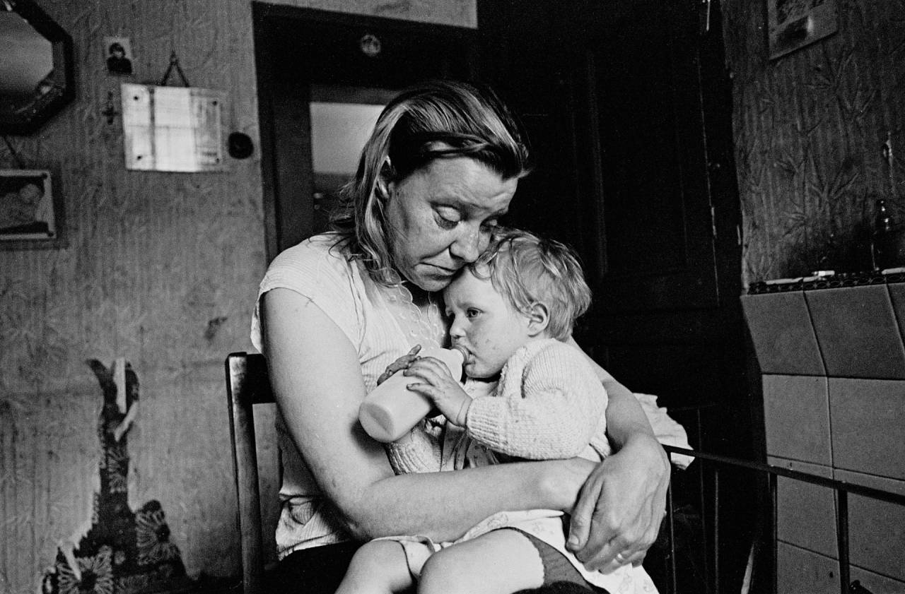 Sheffield, May 1969 Mrs Tandy cuddles the youngest of her five children. The family lived in a decaying terraced house owned by a steelworks. She had no gas, no electricity, no hot water, no bathroom. Her cooking was done on the fire in the living room