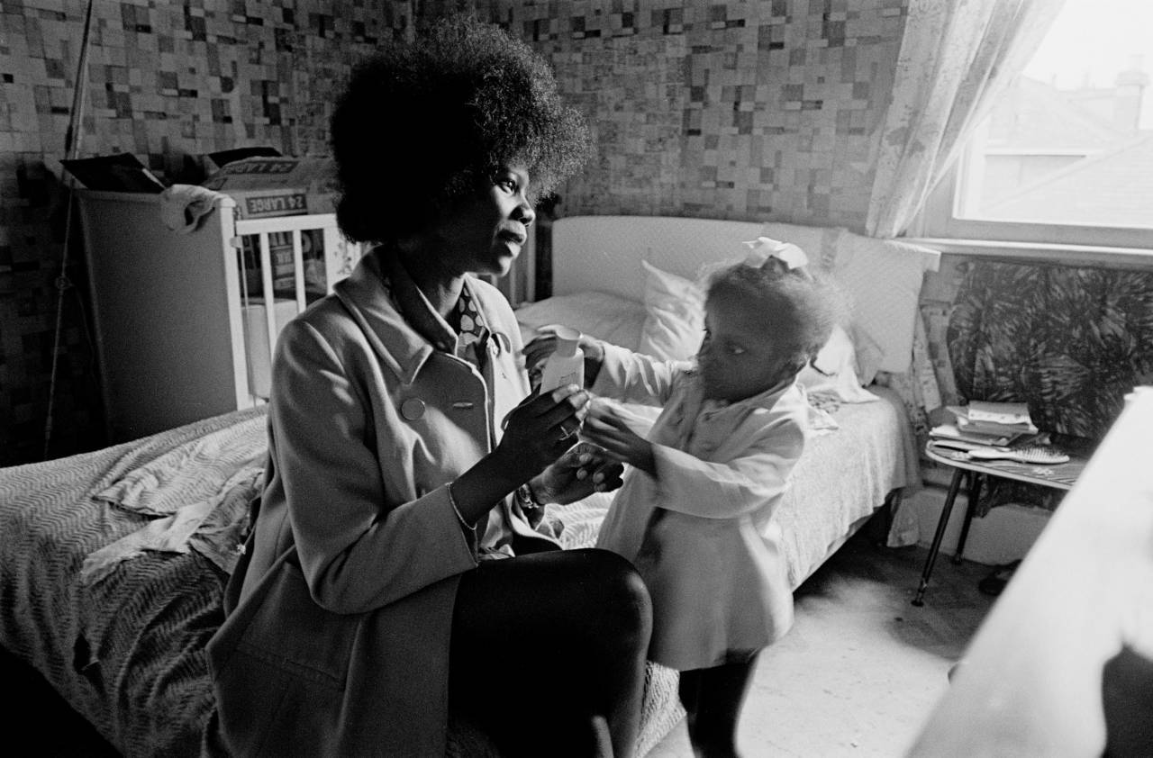 Single mum living in a single room Notting Hill 1972