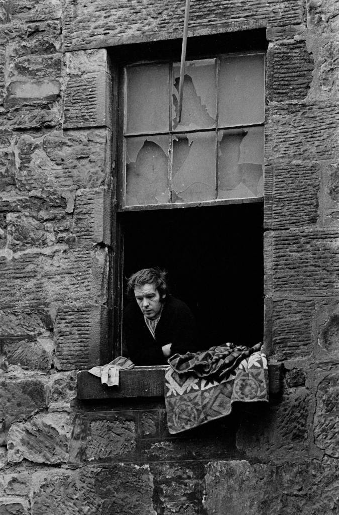 Unemployed colliery worker, Glasgow tenement 1971