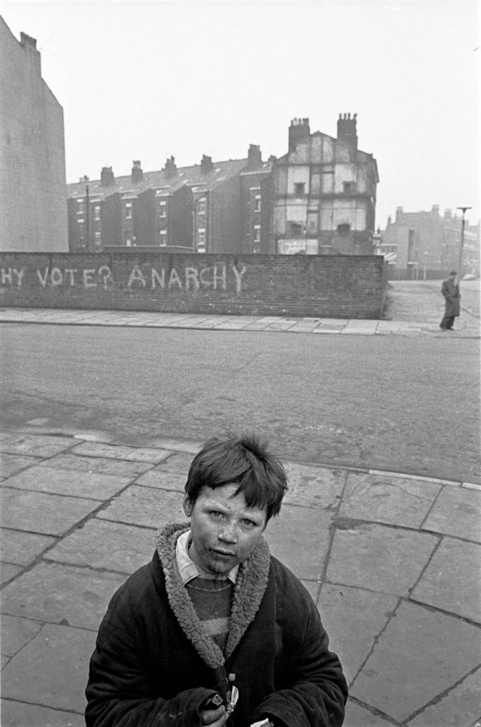 Young lad on the corner of a Liverpool 8 street, 1969