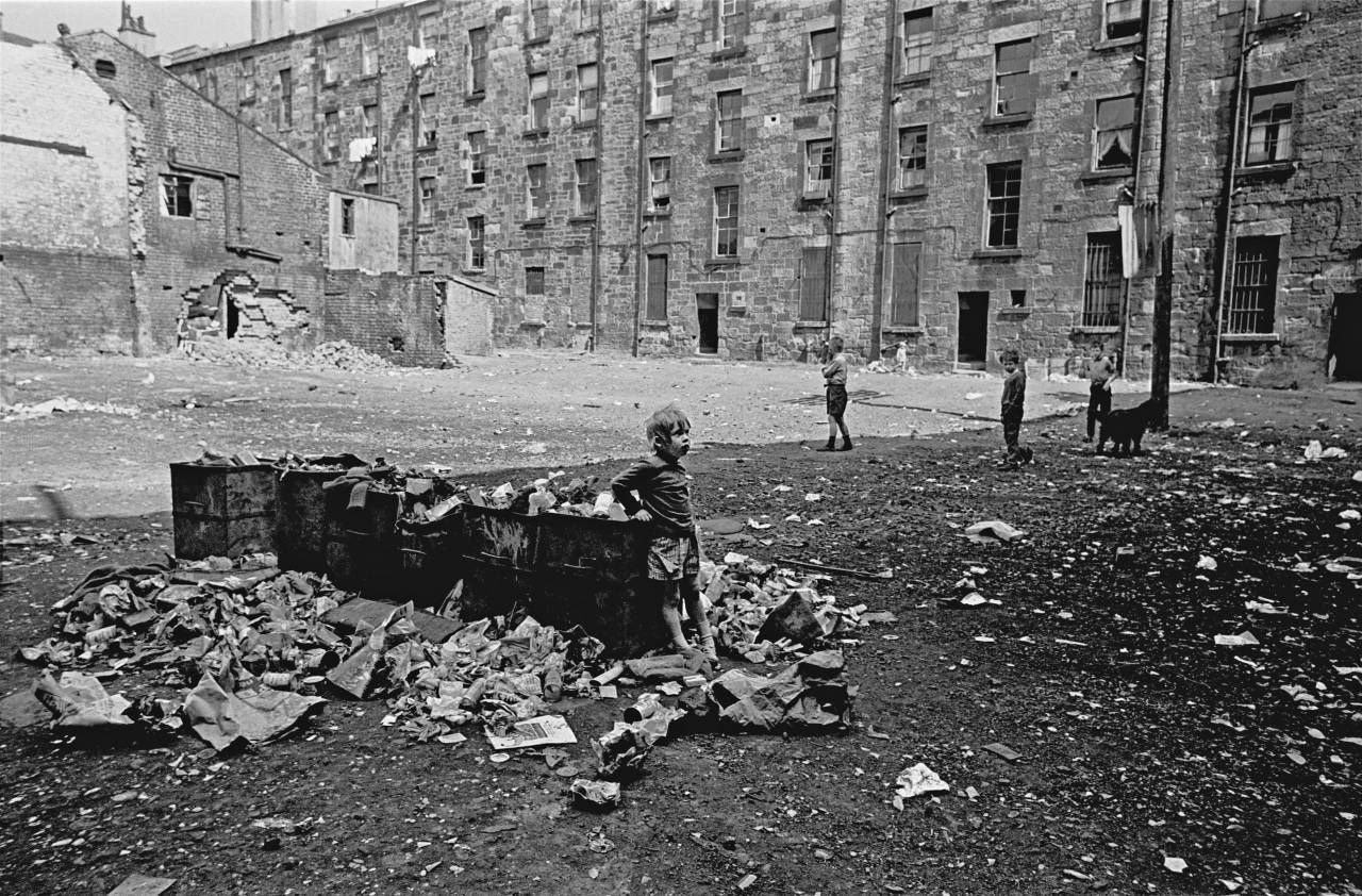 Child on a tenement staircase, Glasgow 1971