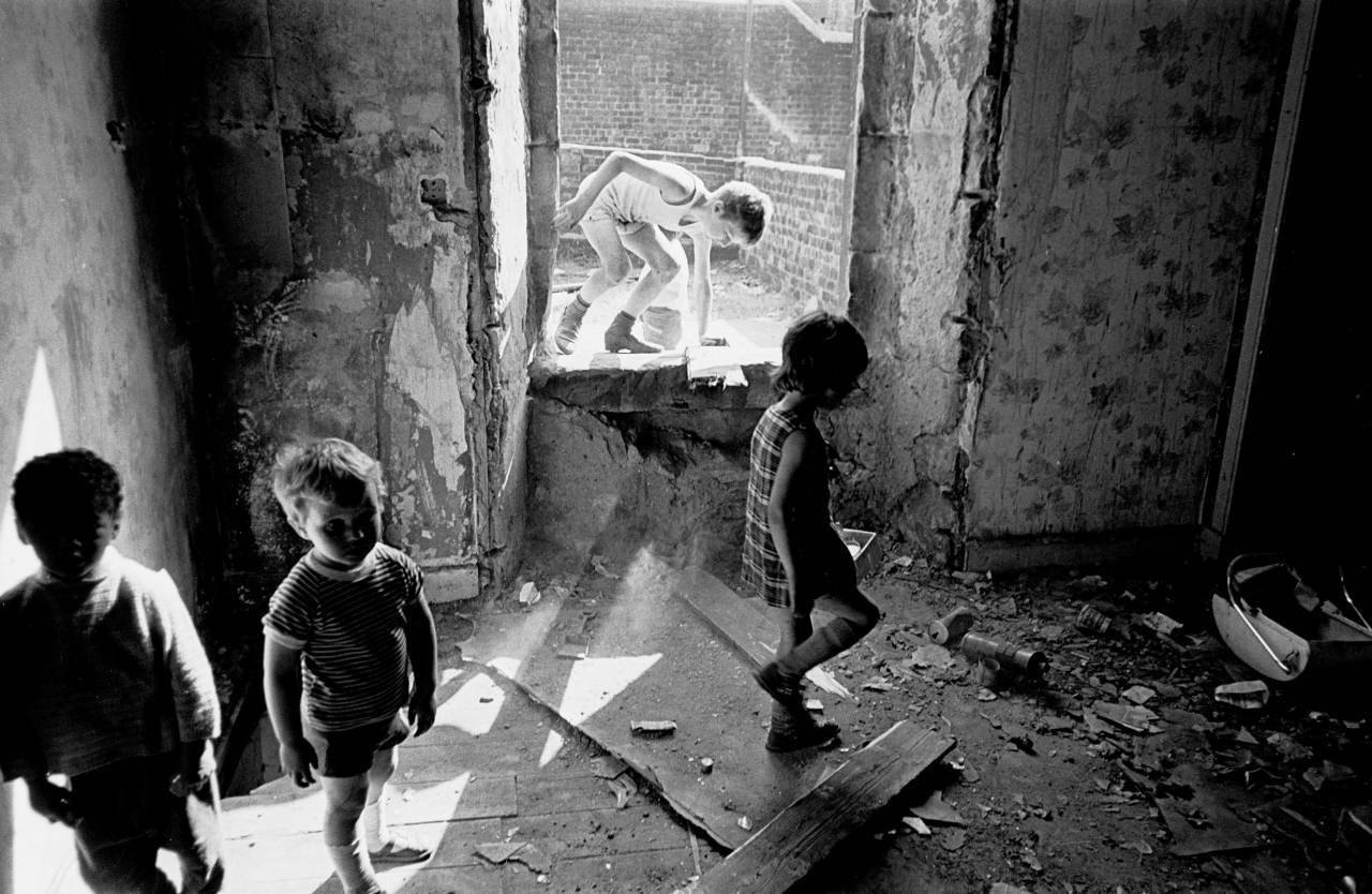 Children playing in a derelict tenement, Glasgow